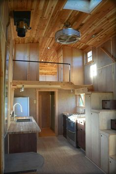 Love how the loft is somewhat partitioned and has a rail.