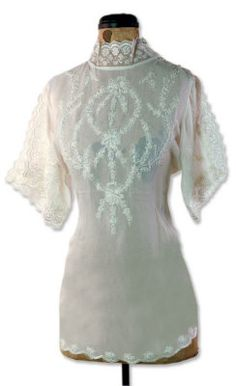 Also in black, but hard to show details of the embroidery ~ love the curved hemline