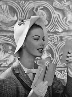 A jaunty upturned brim ads interest to this stylish hat from 1957.