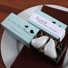 Unique Love Bird Salt And Pepper Shaker Wedding Favors These chic Love Birds are truly engaging. Finely crafted in white porcelain, these modern and romantic salt and pepper shakers make adorable favors for weddings, baby or bridal showers. The exquisite packaging features a pullout box with the two Love Birds comfortably nesting inside. Die cut openings in the box cover allows a small peek into the interior. For added charm, personalize this gift using the versatile Love Bird Paper Band.