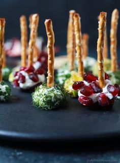 Everyone loves a good cheese ball, but your guest will fall in love with these Assorted Holiday Goat Cheese Balls coated with a combination of fresh dill, chives, pistachios, and pomegranate seeds!