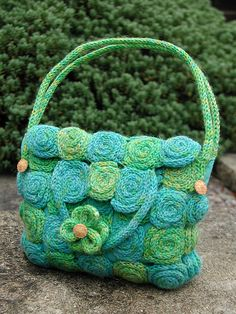Ravelry: Spirals french knitted bag pattern by Debbie Tomkies.  2.50