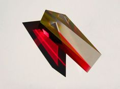 Catching and throwing light from all the right angles, the peculiar, prismatic acrylic pieces from sculptor Phillip Low look like something from outer space. Tip-toeing on the line between art and...