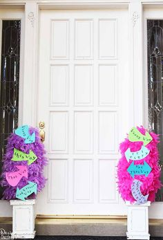 Alice in Wonderland feather boa topiary with FREE printables - This way, That way, Mad Hatters Way signs.  Party Idea from MichaelsMakers Design Dazzle
