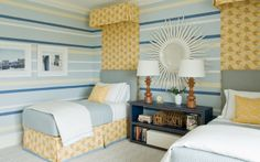 Striped walls in shades of blue and yellow coordinate with simple blue upholstered headbaords with a yellow floral crown and drape that match the pleated bedskirts in a twin bedroom Shared Bedrooms, Guest Bedrooms, Home Bedroom, Bedroom Decor, Bedroom Ideas, Kids Bedroom, Grey And White Bedding, Blue Headboard, Paint Headboard
