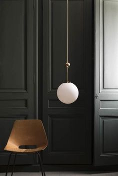 Apparently the epitome of simplicity, which turns out to be pretty sophisticated... The small brass sphere is more than simply pretty: because it slides, it adjusts the proportion of the lamp relative to its surrounding space. Materials: brass and hand blown glass.…