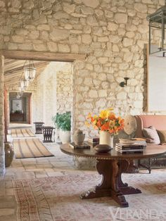 """Despite the weighty presence of stone, the house radiates an airy lightness, courtesy ofSmith's vision: """"I wanted it to be younger and to give it more of the unexpected."""" Rather than simulate a country French or Tuscan aesthetic, his goal was """"to capture the voice of Arizona."""" Grey Crawford  - Veranda.com"""