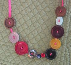 Button necklace idea for a Lalaloopsy party