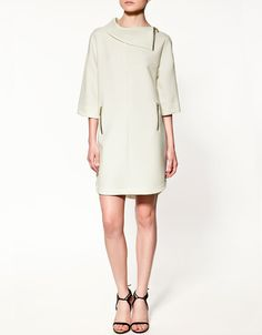 Loved the zipped neckline! Tunic with Zips from Zara...with tall boots