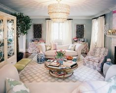 Living Room Color - A neutral color palette with light-blue walls in a living room