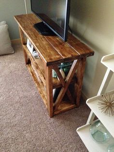 "Rustic TV stand with ""X"" designs on the sides. Also works as a bookshelf. #DIY"