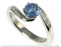 Platinum blue sapphire twist ring with pave set shoulder diamonds ~ Harriet Kelsall Jewellery Design
