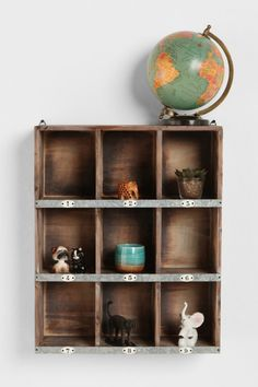 Urban Outfitters pigeonhole box storage shelves vintage industrial style.