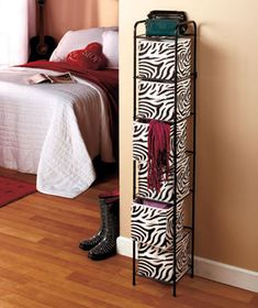 """6-Bin Storage Units A 6-Bin Storage Unit fits into small spaces in just about any room. It comes with 6 nonwoven bins with 4"""" handles so you can easily remove them from the rack. Use them to hold everything from bathroom to bedroom accessories. Tall and slim, the metal frame has plastic-tipped feet that won't scratch your floor. It has a small rack on top for extra space or light decorative items. The Purple choice bins come in graduated shades of light and dark purple. $29.95 each"""