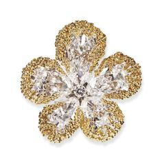 AN EXQUISITE DIAMOND AND GOLD FLOWER BROOCH, BY VAN CLEEF & ARPELS