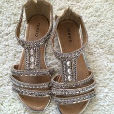 Torrid beaded sandals A gladiator sandal that slays with built-in sparkle. The creamy faux leather cage straps are embellished with all sorts of shine - from rhinestones to silver tone studs and chains. Brand new with tags. Never worn. torrid Shoes Sandals