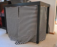 Hide your litter box in plain sight with an IKEA LACK table and a few modifications.