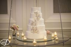 Another wedding, another cake with delicate rose detailing. Unlike the rest, this cake was done in a flat, muted tone. The color or a fleshy, dusty rose, Halona & Rocky Bernard wanted something classic and elegant. Cake by Four Seasons Las Vegas Weddings. Photo by AltF Photography.