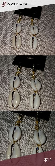 2 tier cowrie shells earrings on lever backs 2 tier gold wire cowrie shells earrings on surgical steel lever backs ear wires. 2 inches in length light weight Jewelry Earrings