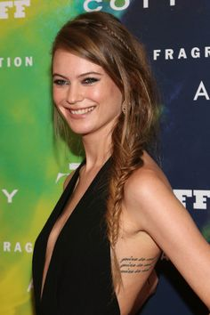 Behati's fusion of plait styles is a cool new take on the tress trend. A skinny braid shapes the crown like an Alice band might, while the fat fishtail to one side add a bohemian summer vibe. Extra cool points for the messy finish.