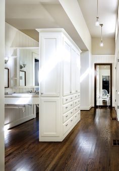 Bath suite dressing room - never seen the space divided in this way, looks interesting. Lots of us hesitate to put wood floors in the bath, but it should be on the list of choices.