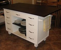 DIY kitchen island from old desk.. Love the wheels! Cover the surface with small tiles?