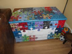 Toybox decorated with Decopatch paper in giant jigsaw shape patchwork.  Very creative.