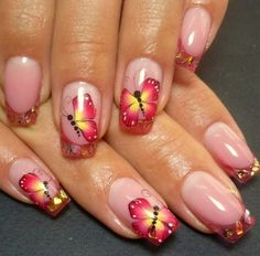 A refreshing butterfly nail art design with French tip. The bright red and yellow colors lighten up the design as the butterfly looks as if it is glowing and hopping over from one nail on to another.