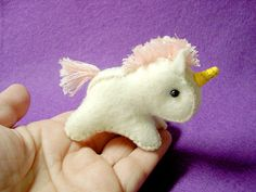 oh wow, talk about tiny! I love this better than those little plastic my little ponies my lil girl loves so much XD