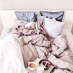 Someone should definitely bring breakfast in bed. | 19 Deliciously Messy Beds You'll Want To Crawl Into Right Now