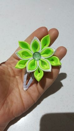 Green and white flower clip