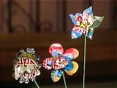 Don't toss those old cans, turn them into funky flowers that add a colorful touch to any garden, from DIYNetwork.com.