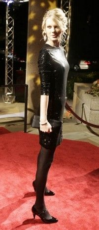 Taylor Swift on the red carpet at the BMI Country Awards in 2007.
