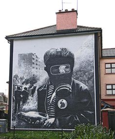 Mural in Derry Ireland Battle of the Bogside Painted by the Bogside Artists: Tom Kelly, his brother William Kelly, and Kevin Hasson Photo by Sean Mack