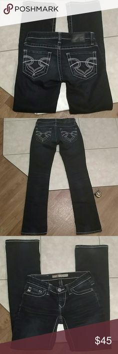Big star jeans Dark blue Casey slim boot low rise fit. A little fray on the ends of the inseam of 31 inches. Good used condition. Rise is 6 inches with the waist flat measuring 14.5 inches. Has a great stretch with 72% cotton 26% polyester and 2% Spandex Big Star Jeans Boot Cut