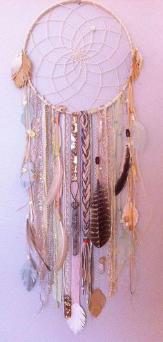 Easy DIY Feather Dream Catcher.                                                                                                                                                                                 Plus