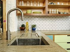 """Here, rich surface variation and an integrated drainboard create the custom look."" 