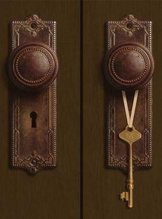 A pair of beautiful antique brown door handles