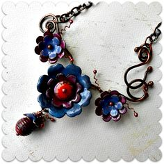 My torch-fired enamel and lampwork by Sue Kennedy, layered and wire-wrapped with copper into a fab necklace.