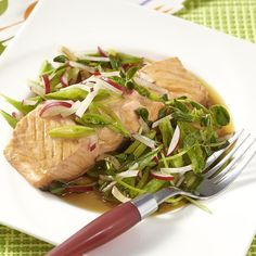 Poaching fish with a little flavorful liquid may be the easiest way to cook fish! This quick poached-fish recipe stars salmon, but tuna, mahi-mahi or cod work just as well. #spring #recipe #eatingwell #healthy