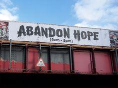 """Abandon hope (9am-5pm)"" by Banksy (East London 2006)"