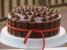 omg...  cake decorated with pips of HERSHEY'S Milk Chocolate and HERSHEY'S KISSES Milk Chocolates