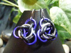 tao earrings purple    $6.00