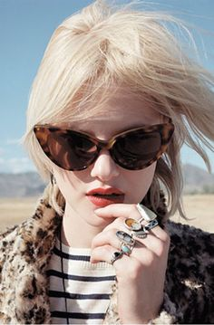 Cat eyes, stripes + animal print, big rings, red lips.  I would wear this, fo sho.