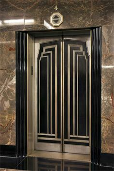 Elevator doors inside Empire State building.  Not accessible to visitors going to top.  I fell in love with the interior design.