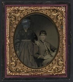 [Unidentified soldier in Union uniform with unidentified woman in dress]