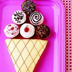 We-All-Scream-For-Ice-Cream Cake A cake mix and canned frosting create an easy dessert shaped like ice cream cones, which is fun for a birthday party.