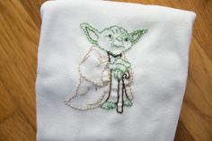 hand embroidered Yoda onesie made to order by jhouseward on Etsy