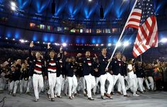 Michael Phelps served as the Team USA flag bearer at the Opening Ceremony of the 2016 Olympic Games. (Photos: Getty Images)