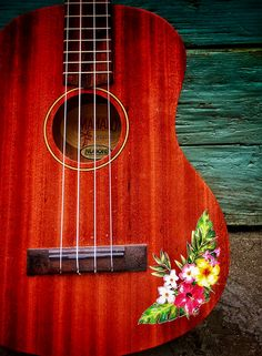 Ukulele sticker of tropical hibiscus flower and fern combination. Perfect stylish decor to compliment your ukulele